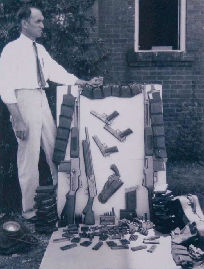 """The arsenal of weapons and ammo discovered in the """"death car"""" of Bonnie Parker and Clyde Barrow on May 23, 1934."""