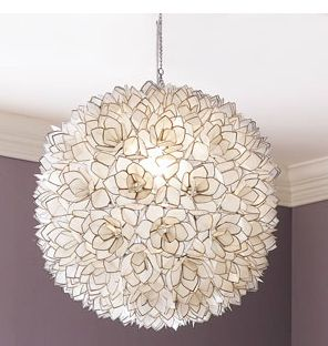 horchow capiz shell light fixture. I love the light and color of the wall for one of the girls room.