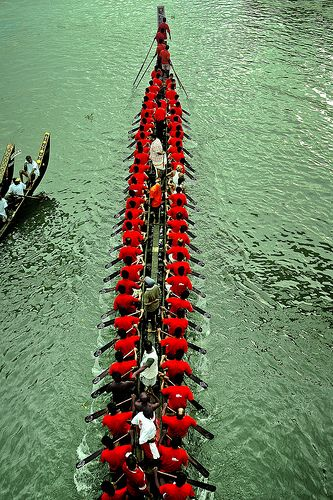 Racing in Red - Champakara Boat Race. Onam Festival in Kerala [ the south-west of India on the Malabar coast]