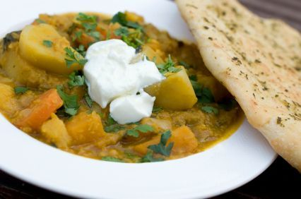 Slow Cooker Vegetable Curry.     Less than 200 cals/serving, low in fat, high in fibre, and no cholesterol. I'm cooking it right now and it smells divine!