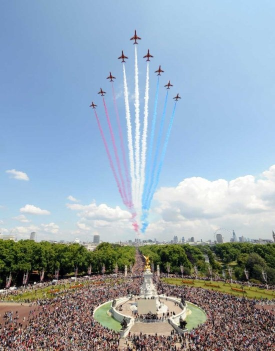 Royal Airforce planes fly past Buckingham Palace on HM the Queen's birthday
