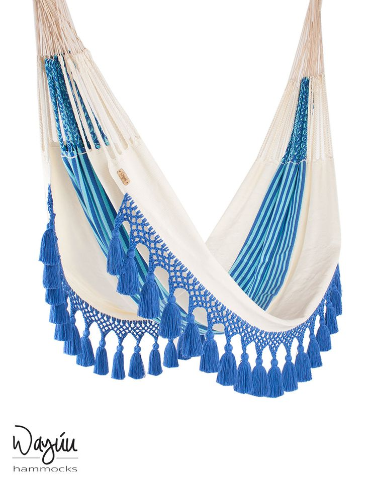 Castaway worries while relaxing in this nautical-inspired hammock, handwoven by expert artisans. Allow your thoughts to drift away with this chic piece, featuring crisp blue and white maritime-inspired stripes and trendy tassels.
