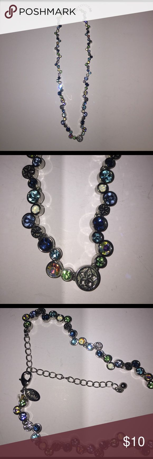 Lia Sophia necklace NWOT Never worn. Given as a gift. Beautiful piece. Just not my style. Silver with blue, aqua, green, etc stones. Lia Sophia Jewelry Necklaces