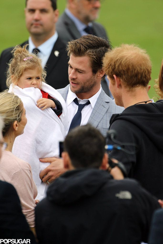 Chris Hemsworth introduced his daughter to Prince Harry! Click through to see the sweet family's pictures.