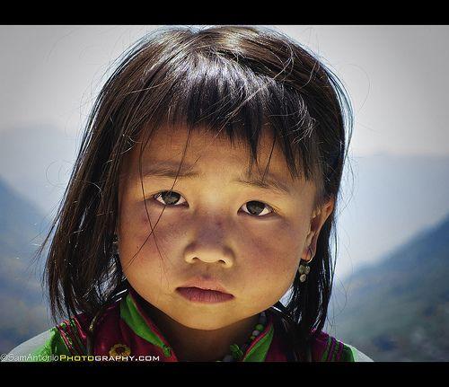So much sorrow. Magnum photographer Robert Capa. Ethnic minority girl in Sapa, Vietnam.