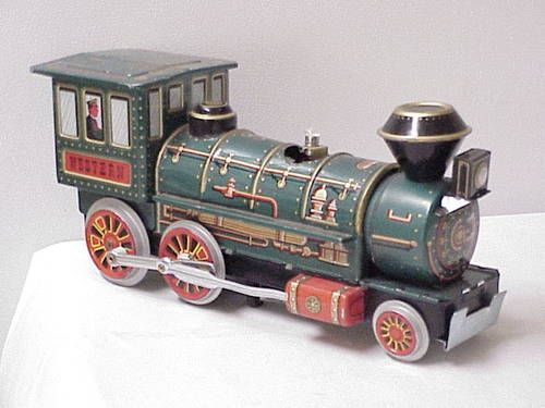 LOVE toy trains. - I swear my brothers had the same one, only with much more following trains and huge tracks.