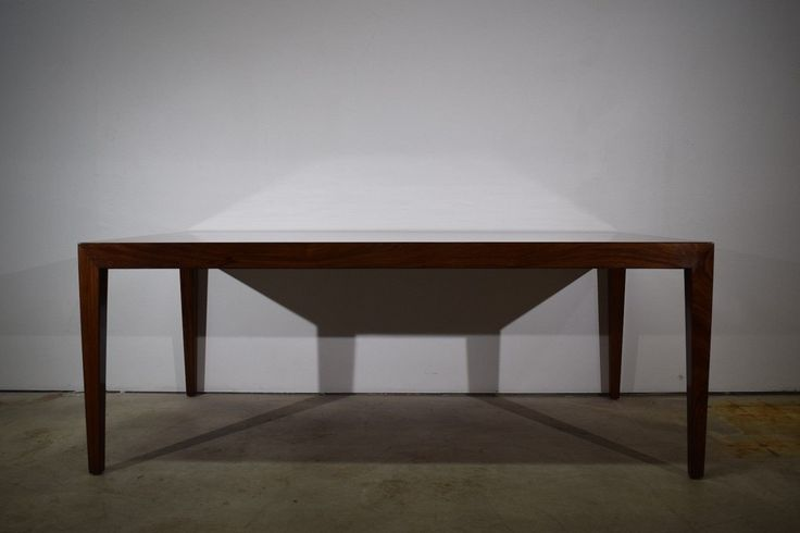 Danish mid century coffee table by Severin Hansen. Produced by Haslev Møbelsnedkeri. Rosewood veneer and solid rosewood legs. Marked by the manufacturer. Danish