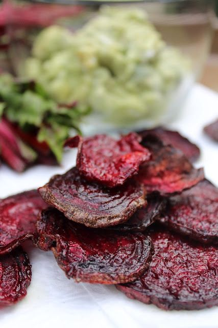 Baked beet chips with avocado and goat cheese dip.