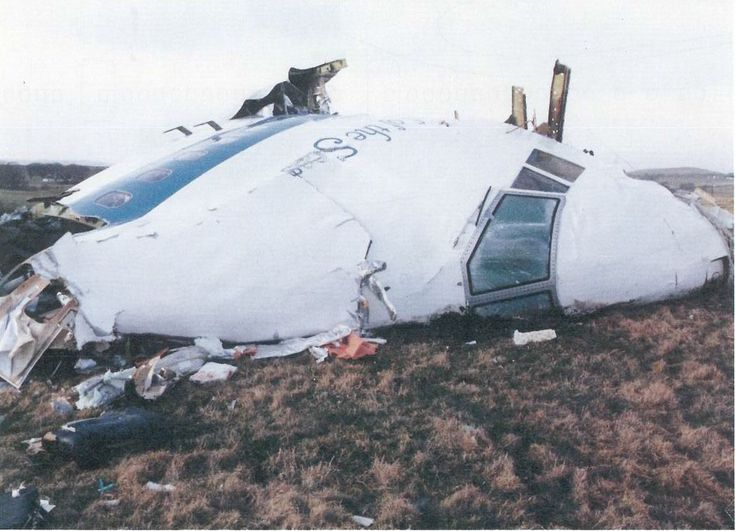 """Pan Am Flight 103. Crashed Lockerbie, Scotland, 21 December 1988 - Pan Am Flight 103 -By Air Accident Investigation Branch - Air Accident Investigation BranchReport No: 2/1990 - Report on the accident to Boeing 747-121, N739PA, at Lockerbie, Dumfriesshire, Scotland on 21 December 1988 Report name: 2/1990 Boeing 747-121, N739PA http://www.aaib.gov.uk/publications/formal_reports/2_1990_n739pa.cfmAppendix B, Image B-9 """"Photograph of nose and flight…"""