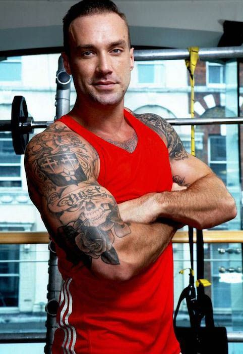 Calum Best showing his bulging biceps...