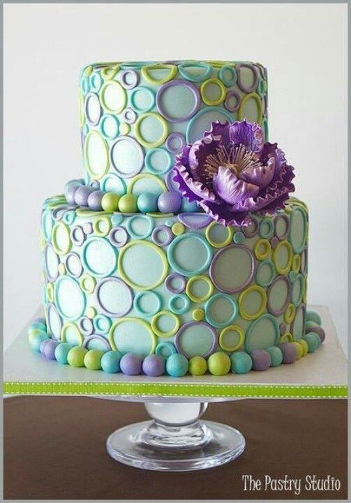 This is cute with beautiful spring colors, but the flower its too much. Its a simple cake, it should be kept simple :) http://www.pinterest.com/ahaishopping/