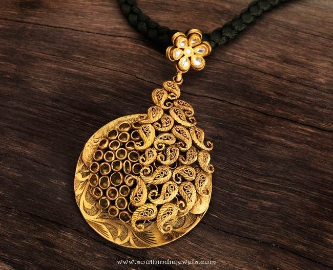 22k gold fancy antique pendant design from Karpagam Jewellers. For inquiries please contact the seller below. Seller Name : Karpagam Jewellers Contact No : 0422 – 4506001 / 2 / 3 Email : karpagamjewellers@yahoo.co.in Website : http://www.karpagamjewellers.com/ Related PostsTemple Jewellery Pendant from Vijay JewellersGold Antique Peacock PendantAntique Gold Emerald Pendant From ArnavGold Kundan Pendant Set …