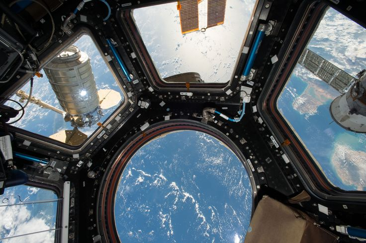 Cygnus Spacecraft Attached to Space Station's Unity Module Orbital ATK's Cygnus cargo craft (left) is seen from the Cupola module windows aboard the International Space Station on Oct. 23 2016. The main robotic work station for controlling the Canadarm2 robotic arm is located inside the Cupola and was used to capture Cygnus upon its arrival. October 25 2016