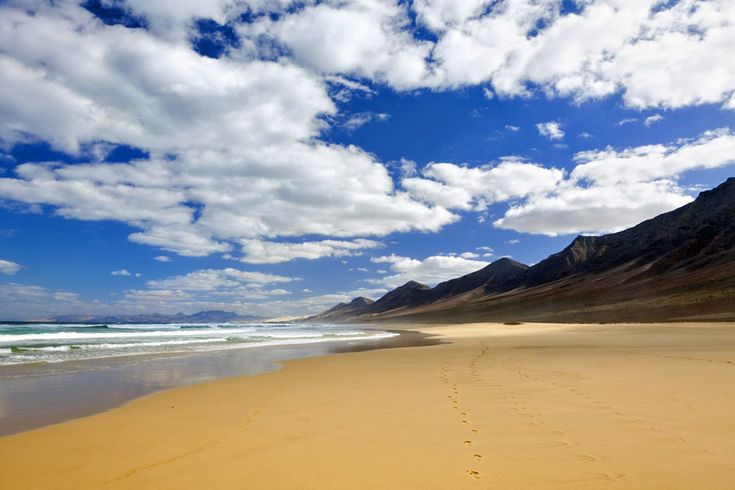 Where to go on holiday in January | http://www.weather2travel.com/holidays/where-to-go-on-holiday-in-january-for-the-best-hot-and-sunny-weather.php |  Cofete Beach, Fuerteventura  © eyewave - Fotolia.com