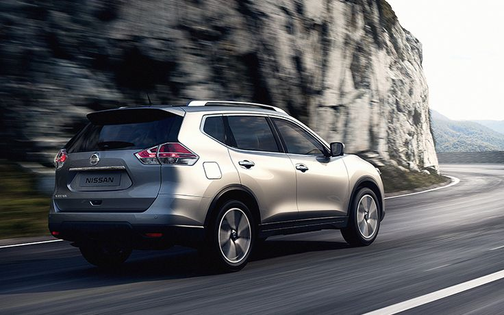 Nissan X-Trail crossovers on the road