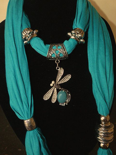 Jewelry Scarves- Turquoise Scarf with a Dragonfly and Stone Pendant. $22,95, via Etsy.
