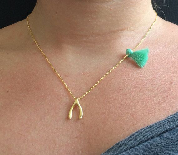 Tiny WishBone Necklace. Little matt gold plated wishbone necklace. Minimalist necklace. Chain Necklace. Layered Necklace The meaning of the wishbone charm is make a wish for Love You can wear this necklace alone or stack it with others!!!So cute and simple! This delicate and dainty necklace is made with: ♥ Gold plated WishBone charm, measures approx 15mm* 10mm ♥ Delicate gold plated chain. Choose the length! ♥Little tassel in different colors Visit my shop for more little things ♥ ♥ ♥ ...