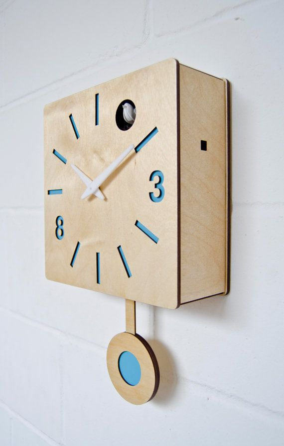 Quadri - Modern Cuckoo clock This cuckoo clock has a little bird that comes out and chirps every hour moving his beak and flapping his wings. As soon