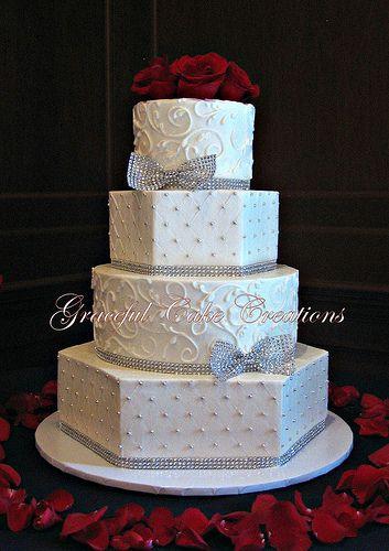 Elegant White Butter Cream Wedding Cake with Silver Bling Ribbon and Bows