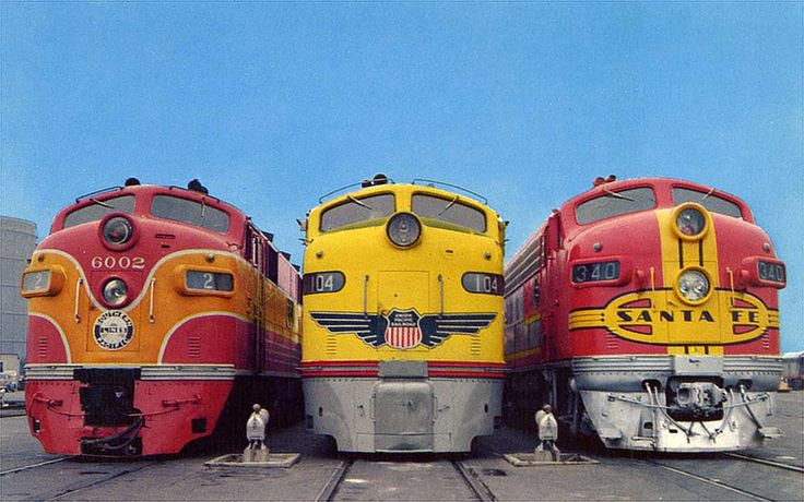 """Southern Pacific's #6002, Union Pacific's #104 and Atchison, Topeka and Santa Fe's #340 on display at Los Angeles Union Station. The diesel-electric locomotives are General Motors Electro-Motive Divsion """"F and E Cab Units"""". Power Output: 1,500 to 2000 hp."""
