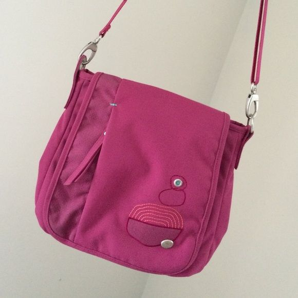 Cute & functional Haiku Wander Bag Barely used condition. Haiku Wander Bag in Raspberry. 11.25 x 10.5 x 4. Carried it in a trip to New York with my kids. All kinds of pockets to stash pens, tickets, cosmetics... Decent size without being too bulky. Haiku Bags Shoulder Bags