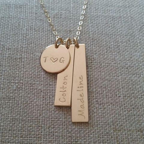 Custom Family Necklace: Parents initials with a heart and children's names.