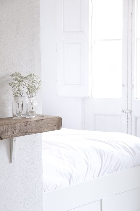 An old thick piece of wood makes a charming shelf. Copy this.