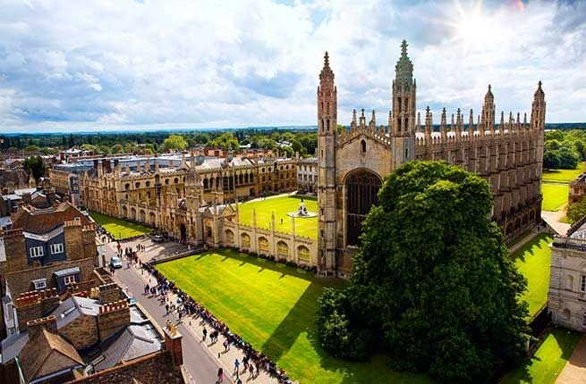 Cambridge University is characterized less by a proper campus than a collection of colleges, medieval churches, courtyards, and wisteria-filled gardens. The town of Cambridge originated in Roman times, and the university dates back to 1209. The exact founding story is unknown, but the version told to Cambridge students recounts that some Oxford scholars chased out after the accidental shooting of a peasant fled to Cambridge, where they established a new university. The prestigious university…