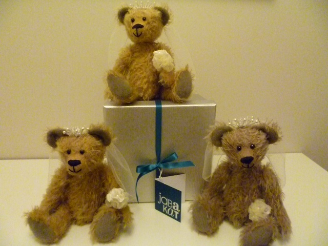 Handmade mohair wedding bears, complete with veil, bouquet and tiara.