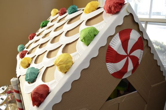 """""""To decorate the roof, I used paper plates cut in half, and then cut out the middles of the plates to use the rims as icing.""""--Life Sized Cardboard Gingerbread House"""