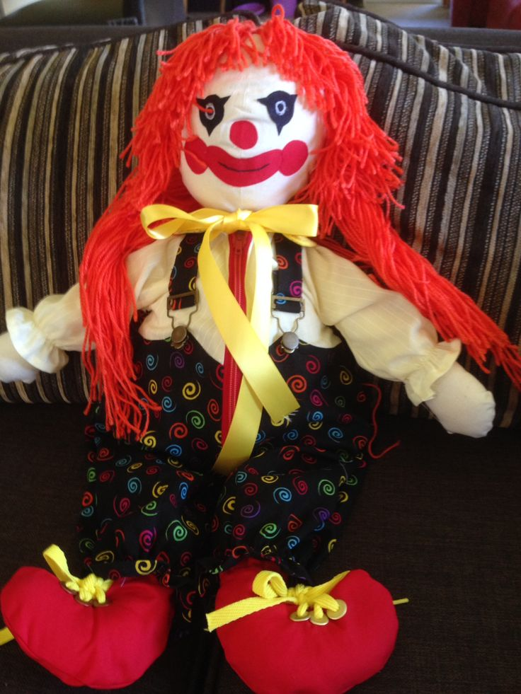Clown learning doll with zip, overall buckles, button, Velcro, and shoe laces. Butterick 3510