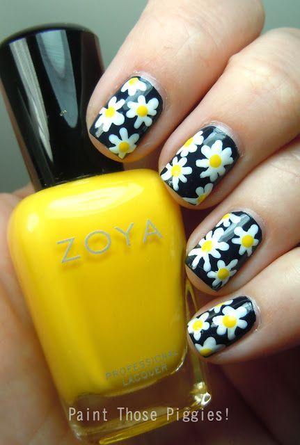 uñas negras diseño de flores
