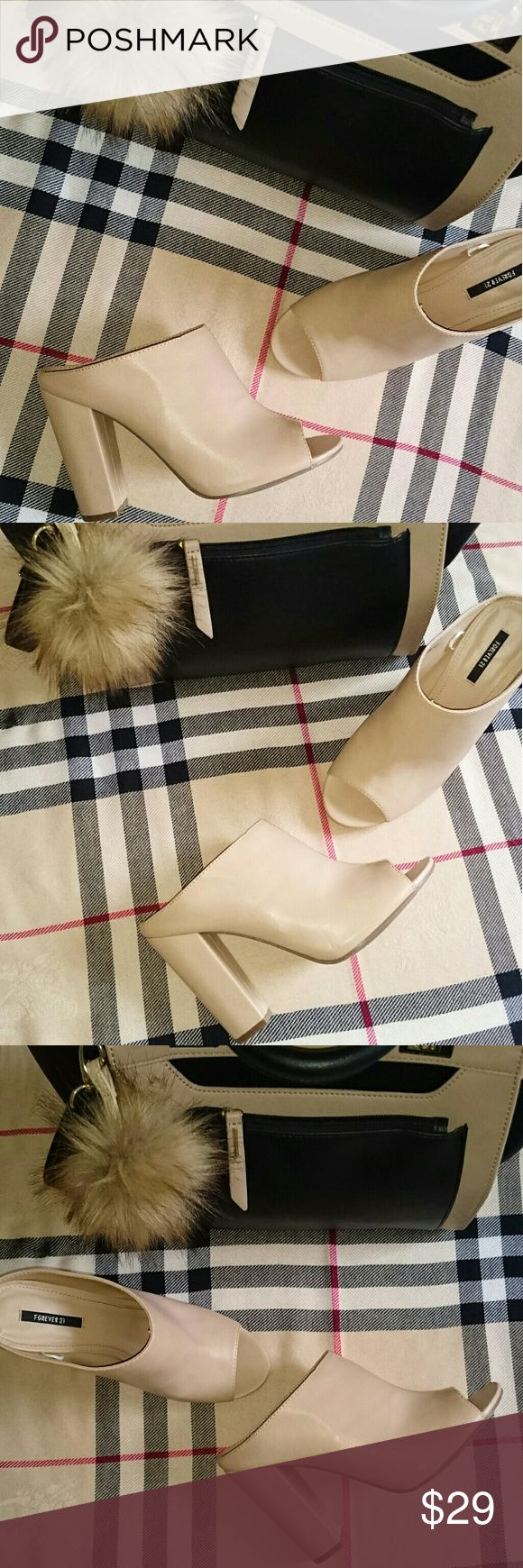 Tan nude open toe chunky block heels mules sandals Excellent never used outside. Soft and comfy apprx 4 inch heel. Nude shade. Only flaw is left show has gray marks. This is Forever 21's affordable version of Vince mule. Vince Shoes
