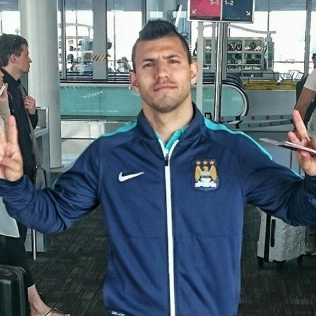 My Baby Aguero at the airport with his passport in his hand ☺