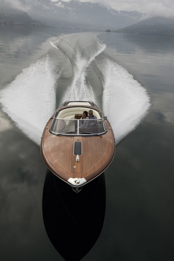 "I'm loving the classy look of this speedboat : Riva Aquariva 33'  - ""Its soft, elegant lines reflect a taste for tradition, the valuable, beautifully carved wooden decks (mahogany inlaid with maple) and leather trimmings of the dashboard and helm highlight the pleasure of sailing in a timeless classic..."""