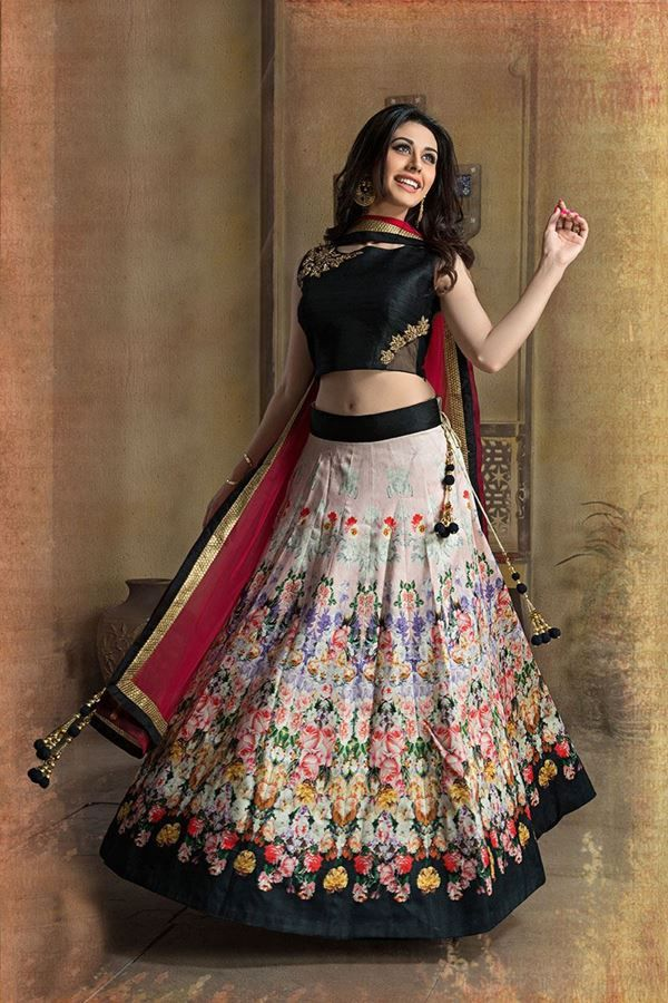 Look sensationally awesome with this multicolor lehenga choli set. Featuring A line printed lehenga, choli portion is of raw-silk material and engraved with zardosi work. Contrast maroon dupatta accompanied is of net material edged with fancy lace borders. Floral printed lehenga is now in trend and blend of elegant colors are used to craft this piece. You can adorn heels and matching danglers to look complete.