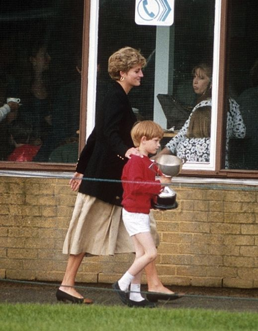 June 09, 1992: Prince Harry carries a trophy as his mother walks beside him. This would be his last sports day at Wetherby shcool