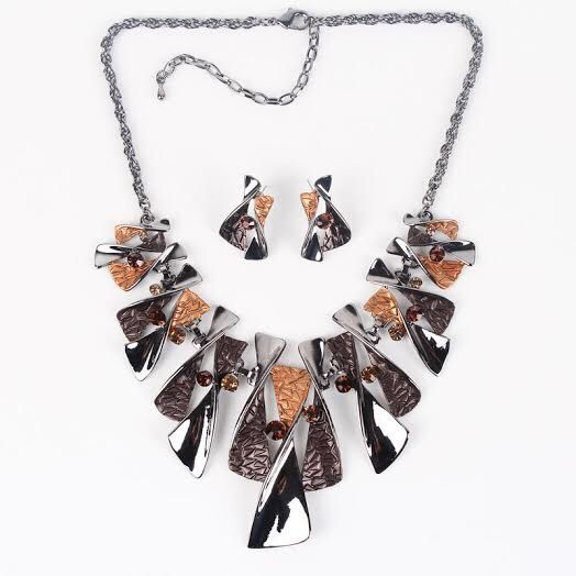 A personal favourite from my Etsy shop https://www.etsy.com/au/listing/399379719/enamel-necklace-bib-necklace-brown