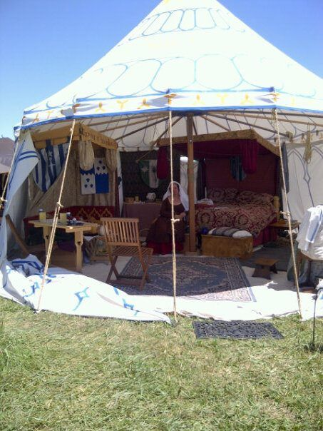 Great Medieval Tent - great look at how the tension is kept with a detachable wall spoke wheel pavilion.