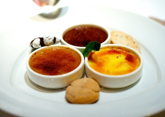 Favorite dessert at Gary Danko in SF. Trio of Creme Brulée with assorted cookies. Chocolate, Hazelnut, and Vanilla to die for : )