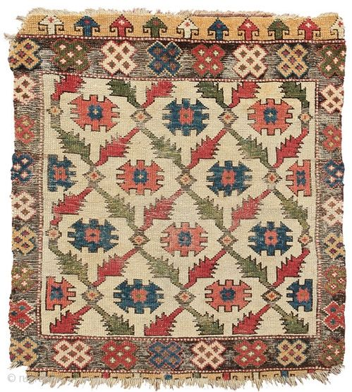 White ground wool rug with tribal emblems, Cappadocia  East central Anatolia, 18th c.