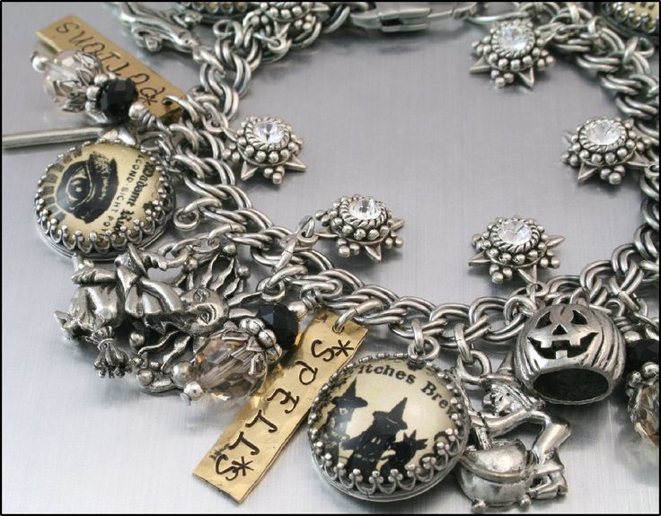 Halloween Jewelry, Silver Charm Bracelet, Moonbeams Magic Shoppe Charm Bracelet, Wiccan Charm Bracelet. $87.00, via Etsy.