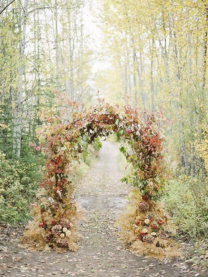 FOR THE CEREMONY || NOVELA BRIDE...Autumn toned floral arch || Where the modern romantics play & plan the most stylish weddings...www.novelabride.com @novelabride #jointheclique