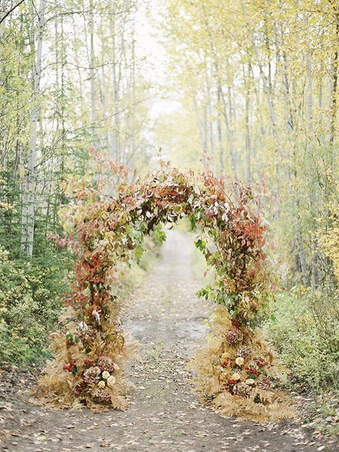 FOR THE CEREMONY || NOVELA BRIDE...Autumn toned floral arch || Where the modern romantics play & plan the most stylish weddings...www.novelabride.com @novelabride #jointheclique