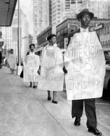 Demonstrators march outside Rich's department store after AU students and MLK were arrested during a Sit-In staged a few weeks before the Presidential election of 1960. The incident forced JFK to intervene and many believe the African American votes he gained as a result were crucial to his victory.