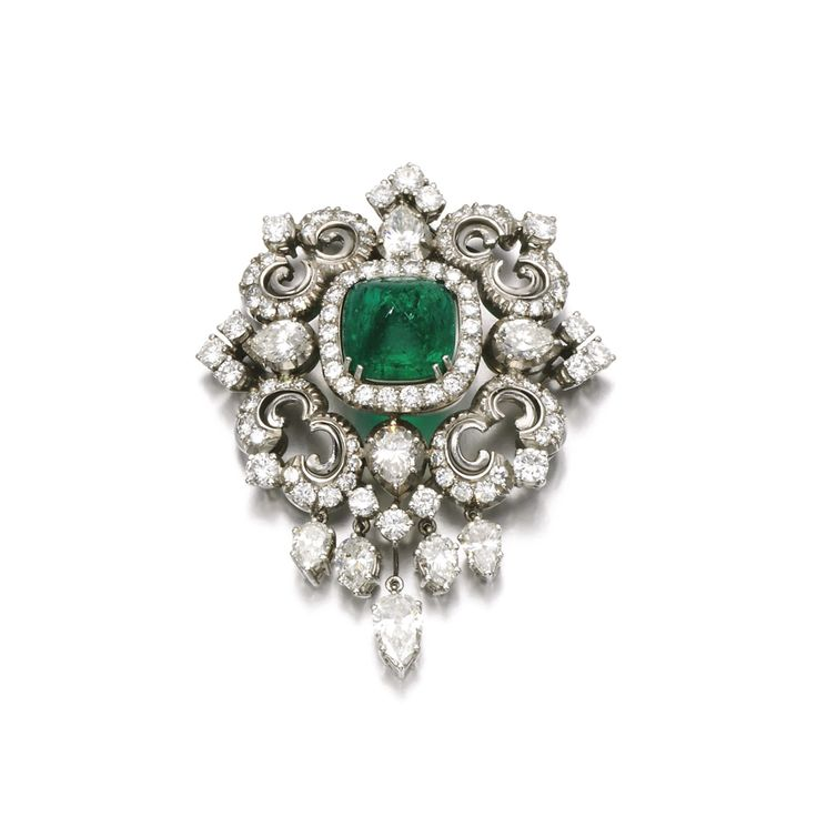 Emerald and diamond brooch/pendant Of scroll design, set with a cabochon emerald, single-, brilliant-cut and pear-shaped diamonds.