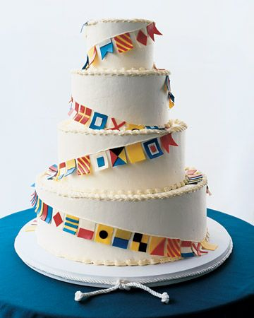 maritime flag cake...these are created from white chocolate, but it would be easy to recreate with printed paper flags, or print onto fabric/canvas for a textured look