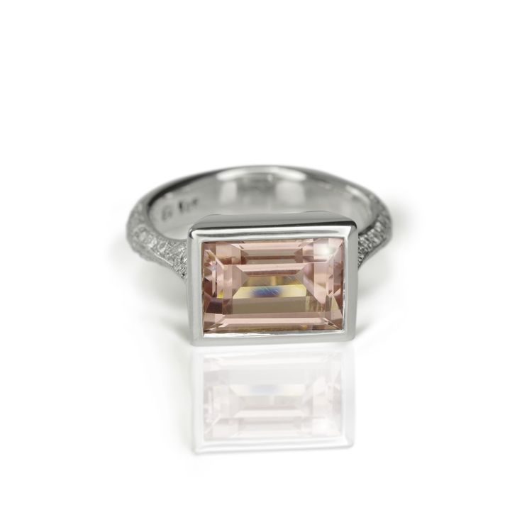 This stunning white gold Pale Pink Tourmaline diamond ring is a Limited Edition showstopper. This is a magnificent cocktail ring that makes a head-turning statement. Solid 9 carat white gold tube set with a beautiful large rectangle step cut pale pink tourmaline. #cocktailRing #pinkTourmaline
