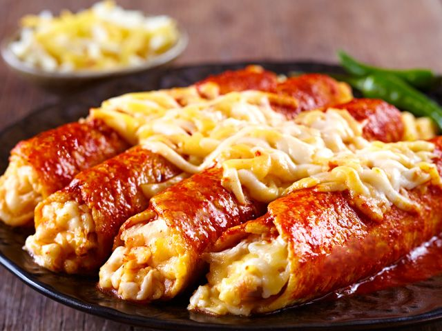 Recipe for Red Chicken Enchiladas. Save on this recipe! Take the Queso IQ Challenge and claim your coupon for new Cacique Shredded Cheese.