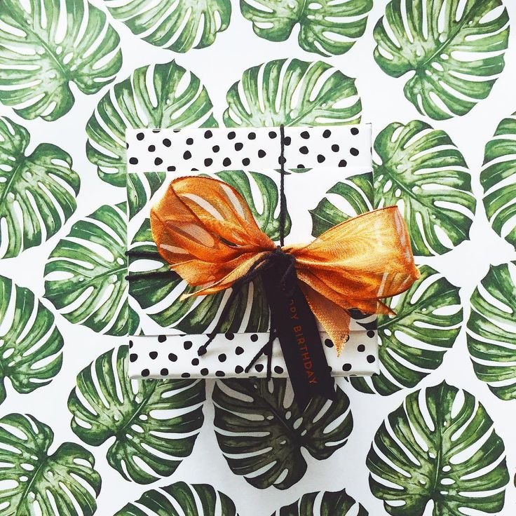 : b•days : Luscious leaves and copper pops for birthday boys • Pebble Black wrapping paper, Monstera belli band, black twisted twine, metallic copper organza and copper flag tag •